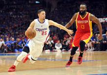 May 8, 2015; Los Angeles, CA, USA; Los Angeles Clippers guard Austin Rivers (25) moves the ball against Houston Rockets guard James Harden (13) during the second half in game three of the second round of the NBA Playoffs. at Staples Center. Mandatory Credit: Gary A. Vasquez-USA TODAY Sports