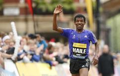 Athletics - Great CityGames Manchester 2015 - Manchester - 10/5/15 Ethiopia's Haile Gebrselassie waves as he approaches the finish line at the end of the Morrisons Great Manchester Run, during an interview afterwards he announced his retirement  Action Images via Reuters / Andrew Boyers Livepic - RTX1CBR6