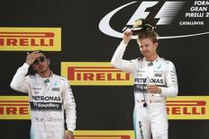 Formula One - F1 - Spanish Grand Prix 2015 - Circuit de Catalunya, Barcelona, Spain - 10/5/15 Mercedes' Nico Rosberg celebrates his win on the podium with Mercedes' Lewis Hamilton Reuters / Gustau Nacarino