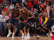 May 10, 2015; Chicago, IL, USA; Cleveland Cavaliers forward LeBron James (23) celebrates with teammates after scoring the game winning basket in the second half of game four of the second round of the NBA Playoffs against the Chicago Bulls at the United Center. Mandatory Credit: Dennis Wierzbicki-USA TODAY Sports