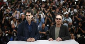 American writer and director brothers Joel (L) and Ethan Coen, Jury Presidents of the 68th Cannes Film Festival, pose during a photocall before the opening of the Film Festival in Cannes, southern France, May 13, 2015. REUTERS/Eric Gaillard