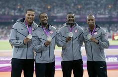 Silver medalists (R-L) Trell Kimmons, Justin Gatlin, Tyson Gay and Ryan Bailey of the U.S. pose after receiving their medals for the men's 4x100m relay  during the London 2012 Olympic Games at the Olympic Stadium August 11, 2012.      REUTERS/Eddie Keogh