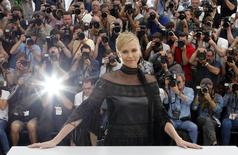 "Cast member Charlize Theron poses during a photocall for the film ""Mad Max: Fury Road"" out of competition at the 68th Cannes Film Festival in Cannes, southern France, May 14, 2015. REUTERS/Regis Duvignau"