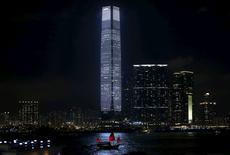 "A tourist junk sails past the 118-storey-high skyscaper International Commerce Centre (ICC), the highest building in Hong Kong, during an audio-visual show ""alpha pulse"" by German artist Carsten Nicolai, as part of the Art Basel programme, in Hong Kong in this May 15, 2014 file photo. REUTERS/Bobby Yip/Files"