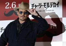 "Actor Johnny Depp poses during a photo session ahead of a news conference for his movie ""Mortdecai"" in Tokyo January 28, 2015.  REUTERS/Toru Hanai"