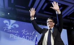 Parti Quebecois leader Pierre Karl Peladeau waves to the crowd after being elected during a ceremony at the convention center in Quebec City, May 15, 2015. REUTERS/Mathieu Belanger