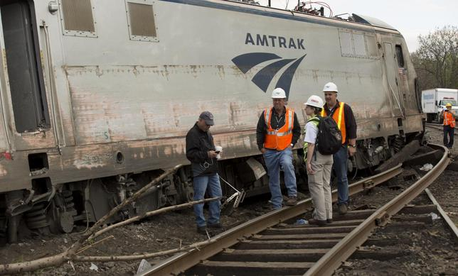 NTSB officials on the scene of the Amtrak train #188 derailment in Philadelphia, May 13, 2015. REUTERS/NTSB/Handout