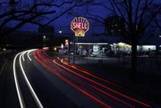 A vintage Shell sign is seen illuminated at a Shell gas station in Cambridge, Massachusetts, December 12, 2014. REUTERS/Brian Snyder