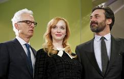 """Mad Men"" stars (L-R) John Slattery, Christina Hendricks and Jon Hamm take part in a donation ceremony at the Smithsonian National Museum of American History in Washington March 27, 2015. REUTERS/Kevin Lamarque"