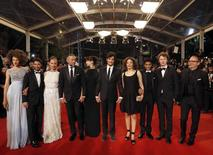 "(L-R) Cast members Chrystele Saint Louis Augustin, Abdel Addala, Emmanuelle Bercot, Vincent Cassel, Director Maiwenn, Louis Garrel, Amanda Added, Nabil Kechouhen, and Norman Thavaud, scriptwriter Etienne Comar, pose on the red carpet as they arrive for the screening of the film ""Mon roi"" in competition at the 68th Cannes Film Festival in Cannes, southern France, May 17, 2015.                             REUTERS/Regis Duvignau"