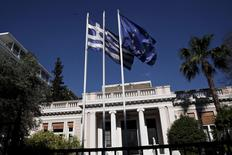 A Greek national flag and a European Union flag flutter outside the Maximos mansion as a government council at the Prime Minister's office takes place, in Athens May 13, 2015. REUTERS/Alkis Konstantinidis