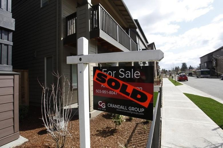 Sold homes are seen in the southwest area of Portland, Oregon March 20, 2014.   REUTERS/Steve Dipaola