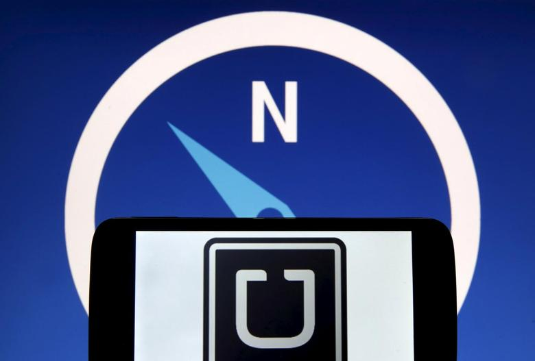 Uber logo is seen on a smartphone in front of a displayed logo of HERE, Nokia Oyj's map business, in Zenica, Bosnia and Herzegovina, in this May 8, 2015 photo illustration.  REUTERS/Dado Ruvic
