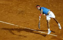 Rafael Nadal of Spain serves to Stan Wawrinka of Switzerland during their men's quarter-final match at the Rome Open tennis tournament in Rome, Italy, May 15, 2015. REUTERS/Stefano Rellandini