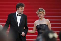 "Director Nanni Moretti (L) and cast member Margherita Buy (R) walk on the red carpet as they leave after the screening of the film ""Mia madre"" (My Mother) in competition at the 68th Cannes Film Festival in Cannes, southern France, May 16, 2015.    REUTERS/Benoit Tessier"