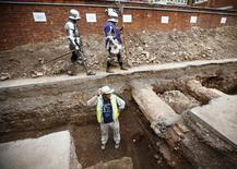 Archaeologist Mathew Morris stands in the trench where he found skeleton remains during an archaeological dig to find the remains of King Richard III in Leicester, central England September 12, 2012. REUTERS/Darren Staples
