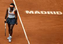 Serena Williams of the U.S. reacts during her semi-final match against Petra Kvitova of the Czech Republic at the Madrid Open tennis tournament in Madrid, Spain, May 8, 2015. REUTERS/Andrea Comas