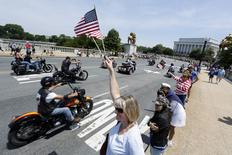 Riders take part in the Rolling Thunder First Amendment Demonstration motorcycle run on Memorial Day by crossing the Memorial Bridge leading from Arlington Cemetery into Washington May 24, 2015. REUTERS/Jonathan Ernst