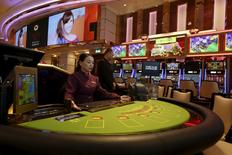 A dealer mans a black jack table at the new Broadway Macau casino, adjacent to Galaxy Macau resort in Macau, China May 26, 2015, one day before its opening.     REUTERS/Bobby Yip