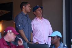 Celebrity comedians Trevor Noah (left) and Jerry Seinfeld (right) watch an opening day game between the New York Mets and the Philadelphia Phillies at Citi Field; April 13, 2015; New York City, NY, USA; Brad Penner-USA TODAY Sports