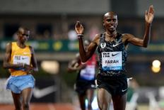 May 29, 2015; Eugene, OR, USA; Mo Farah (GBR) wins the men's 10000 meter run with a time of 26:50.97 and Paul Kipngetich Tanui (KEN) places second with a time of 26:51.86 and Geoffrey Kamworor places third  with a time of 26:52.65 at Hayward Field. Scott Olmos-USA TODAY Sports