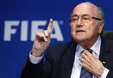 Re-elected FIFA President Sepp Blatter gestures during news conference after an extraordinary Executive Committee meeting in Zurich, Switzerland, May 30, 2015.  REUTERS/Arnd Wiegmann
