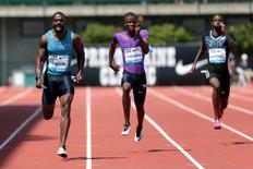 Justin Gatlin (USA) wins the mens 200 meter dash 19.68 (wind 0.9) and Anaso Jobodwana (RSA) places second with a time of 20.04 and Curtis Mitchell (USA) places sixth with a time of 20.44 at Hayward Field. Mandatory Credit: Scott Olmos-USA TODAY Sports