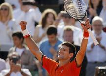 Novak Djokovic of Serbia celebrates after defeating Rafael Nadal of Spain during their men's quarter-final match during the French Open tennis tournament at the Roland Garros stadium in Paris, France, June 3, 2015.          REUTERS/Vincent Kessler  -