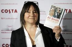 "Ali Smith, Nominee in the 2014 Costa Book Awards and winner of the Costa Novel Award category, poses with her book ""How to be Both"" prior to the announcement of the overall winner, in London, January 27, 2015. REUTERS/Peter Nicholls"