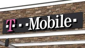 The T-Mobile store sign is seen in Broomfield, Colorado February 25, 2014. REUTERS/Rick Wilking