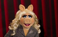 Muppet character Miss Piggy poses during a photocall promoting the movie 'The Muppets' in Berlin, in this file photo taken January 18, 2012.    REUTERS/Thomas Peter/Files