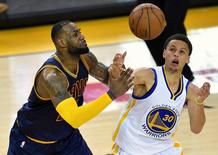 Golden State Warriors guard Stephen Curry (30) steals the ball away from Cleveland Cavaliers forward LeBron James (23) during the overtime period in game one of the NBA Finals. at Oracle Arena. Mandatory Credit: Bob Donnan-USA TODAY Sports