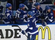 Jun 6, 2015; Tampa, FL, USA; Tampa Bay Lightning defenseman Jason Garrison (5) is congratulated by teammates after scoring a goal against the Chicago Blackhawks in the third period in game two of the 2015 Stanley Cup Final at Amalie Arena. Reinhold Matay-USA TODAY Sports