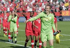 Jun 6, 2015; Edmonton, Alberta, CAN; Canada goalkeeper Erin McLeod (1) celebrates after defeating China 1-0 in a Group A soccer match in the 2015 women's World Cup at Commonwealth Stadium. Erich Schlegel-USA TODAY Sports