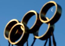 The moon is pictured through a sculpture in front of the International Olympic Committee (IOC) headquarters in Lausanne December 9, 2009. REUTERS/Denis Balibouse