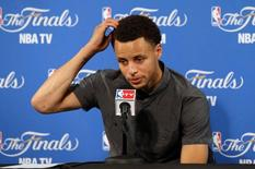 June 7, 2015; Oakland, CA, USA; Golden State Warriors guard Stephen Curry speaks to media following the 95-93 loss against the Cleveland Cavaliers in game two of the NBA Finals at Oracle Arena. Mandatory Credit: Kelley L Cox-USA TODAY Sports