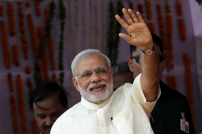 Prime Minister Narendra Modi waves towards his supporters during a rally in Mathura, May 25, 2015.  REUTERS/Adnan Abidi