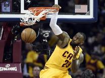 Jun 9, 2015; Cleveland, OH, USA; Cleveland Cavaliers forward LeBron James (23) dunks the ball against the Golden State Warriors during the first quarter in game three of the NBA Finals at Quicken Loans Arena. Mandatory Credit: Bob Donnan-USA TODAY Sports