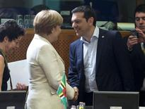 German Chancellor Angela Merkel (L) shakes hands with Greek Prime Minister Alexis Tsipras (R) at the start of an EU-CELAC Latin America summit in Brussels, Belgium June 10, 2015.  REUTERS/Yves Herman