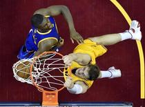Jun 9, 2015; Cleveland, OH, USA; Cleveland Cavaliers center Timofey Mozgov (20) dunks the ball over Golden State Warriors center Festus Ezeli (31) in game three of the NBA Finals at Quicken Loans Arena. Mandatory Credit: Bob Donnan-USA TODAY Sports