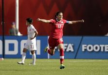 Jun 6, 2015; Edmonton, Alberta, CAN; Canada forward Christine Sinclair (12) celebrates scoring a goal on a penalty kick against China goalkeeper Wang Fei (not pictured) during the second half in a Group A soccer match in the 2015 women's World Cup at Commonwealth Stadium. Mandatory Credit: Erich Schlegel-USA TODAY Sports