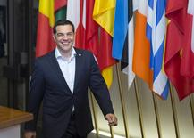 Greek Prime Minister Alexis Tsipras leaves the European Council headquarters on the first day of an EU-CELAC Latin America summit in Brussels, Belgium June 11, 2015.  REUTERS/Yves Herman