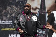 Rapper Rick Ross performs during an official weigh-in for Floyd Mayweather Jr. of the U.S. and Marcos Maidana of Argentina ahead of their welterweight boxing match at the MGM Grand Garden Arena in Las Vegas, Nevada September 12, 2014.     REUTERS/Steve Marcus