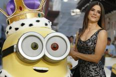 "Actress Sandra Bullock poses with a character in costume from the film during the ""Minions"" World Premiere at Leicester Square in London, Britain June 11, 2015.  REUTERS/Luke MacGregor"