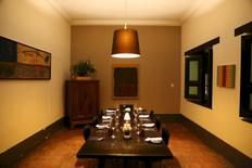 "A dining area of ""La Isabela"" is seen at restaurateur Eduardo Moreno's home which doubles as a restaurant, in Caracas June 6, 2015. As with living-room restaurants that flourished in nineties Havana after the fall of its Soviet benefactor, Caracas is seeing a rise in clandestine dining as inventive restaurateurs seek ways to survive economic crisis, corruption and crime. REUTERS/Girish Gupta"