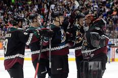 Mar 5, 2015; Glendale, AZ, USA; The Arizona Coyotes celebrate after the shootout against the Vancouver Canucks at Gila River Arena. The Coyotes won 3-2 in a shootout Mandatory Credit: Joe Camporeale-USA TODAY Sports - RTR4S9KV