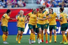 Jun 12, 2015; Winnipeg, Manitoba, CAN; Australia forward Kyah Simon (17) is congratulated by forward Caitlin Foord (9)\ after scoring against Nigeria during the second half in a Group D soccer match in the 2015 FIFA women's World Cup at Winnipeg Stadium. Mandatory Credit: Michael Chow-USA TODAY Sports