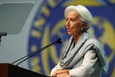 Директор-распорядитель МВФ Кристин Лагард выступает на сессии, проходящей в рамках ежегодной встречи МВФ и Всемирного банка. Вашингтон, 10 октября 2014 года. Международный валютный фонд говорит, что не бросит Украину в случае отказа частных кредиторов реструктурировать евробонды на приемлемых для Киева условиях, и против того, чтобы выделяемая в резервы Нацбанка международная финансовая помощь шла на погашение этого долга. REUTERS/Jonathan Ernst
