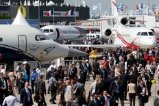 Visitors walk at the static display area during the 51st Paris Air Show at Le Bourget airport near Paris June 16, 2015. REUTERS/Pascal Rossignol