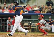 St. Louis Cardinals catcher Rob Johnson looks on as Houston Astros' Chris Carter (L) hits a two-run homer off pitcher Jason Motte during the fifth inning of a MLB spring training game in Kissimmee, Florida in a March 1, 2013 file photo. REUTERS/Steve Nesius/files